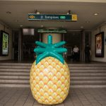 Caltex opens new station with giant pineapple rolling around Singapore city