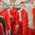 AirAsia unveils red PPE suits for cabin crew